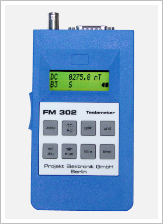 front view magnetic field meter / gaussmeter of series Teslameter FM 302 with two-line LCD display and membrane keypad with keys zero, DC/AC, gain, unit, rel/abs, min/max, filter, time; manufactured by Projekt Elektronik Mess- und Regelungstechnik GmbH Berlin